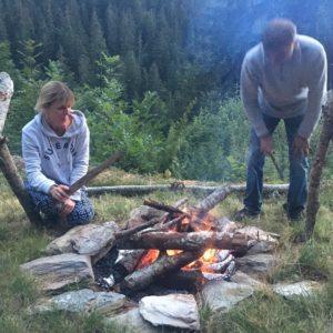 tending campfire rustic yoga retreat